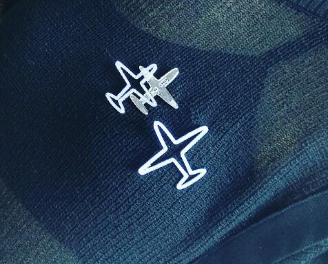 Silver airplane pins